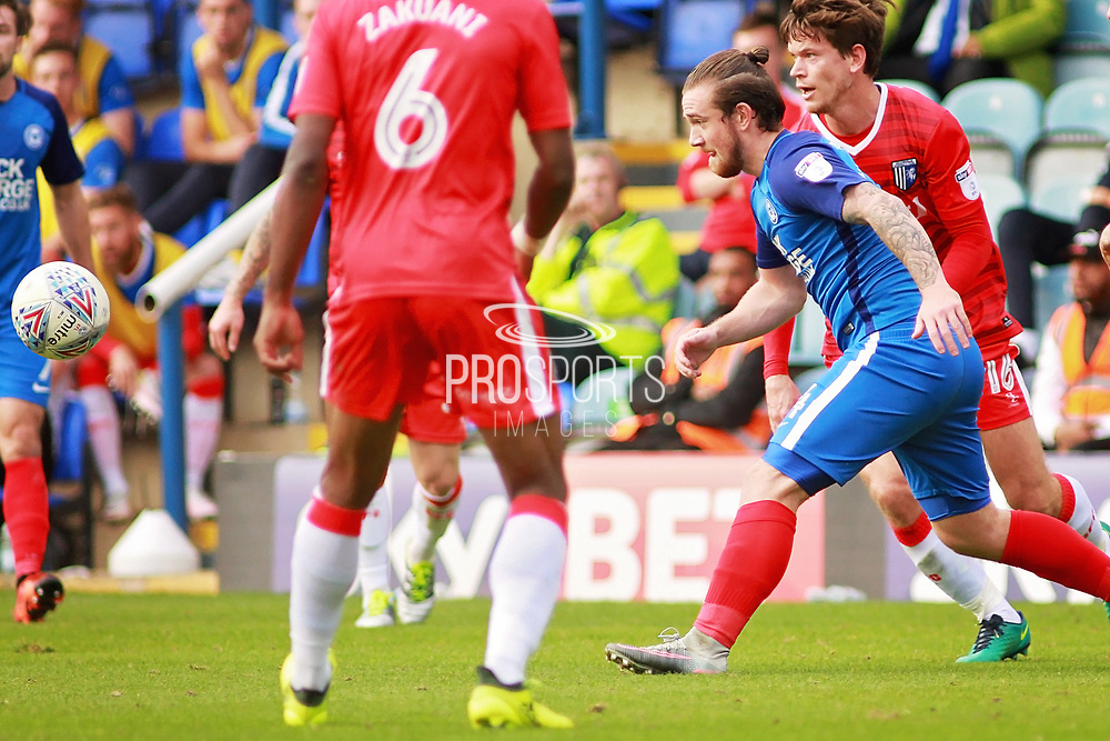 Peterborough United striker Jack Marriott (14) gets outnumbered during the EFL Sky Bet League 1 match between Peterborough United and Gillingham at London Road, Peterborough, England on 14 October 2017. Photo by Nigel Cole.