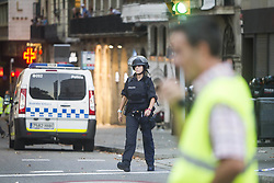 August 17, 2017 - Barcelona, Spain - Spanish policemen stand guard in a cordoned off area after a van ploughed into the crowd, killing 13 persons and injuring over 50 on the Rambla in Barcelona on August 17, 2017. A driver deliberately rammed a van into a crowd on Barcelona's most popular street on August 17, 2017 killing at least 13 people before fleeing to a nearby bar, police said. Officers in Spain's second-largest city said the ramming on Las Ramblas was a 'terrorist attack' (Credit Image: © Hugo FernáNdez Alcaraz/NurPhoto via ZUMA Press)