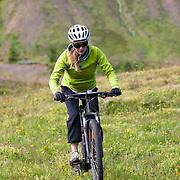 Sunna Björk Bragadóttir mountain biking at Þverá, Skíðadalur, North, Iceland.