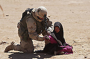 A U.S. Army 3rd Division 3-7 Infantry soldier searches an Iraqi girl during a search and destroy mission March 27, 2003 near the town of An Najaf, Iraq. The 3rd Infantry Division's  push north into Iraq was hampered by pro-Saddam militiamen carrying out ambushes and attacks using small arms and rocket propelled grenades.