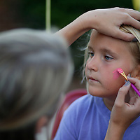 """Thomas Wells   Buy at PHOTOS.DJOURNAL.COM<br /> Ellie Swais, 7, sits quietly and waits for her face to be painted at Friday's Joyner Fall Festival in Tupelo. This year's theme was called """"Joyner Town Fair"""" was was hosted by the schools PTA."""