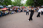 Daehangno theatre and arts district. Hip hop and break dance performance in the rain.