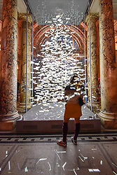 © Licensed to London News Pictures. 28/11/2017. London, UK.  A visitor stands in front of the tree. Es Devlin, a leading stage and performance designer, unveils her design of the annual Christmas Tree in the Grand Entrance at the V&A museum in South Kensington to kick off the museum's Sounds Like Christmas season.  Photo credit: Stephen Chung/LNP