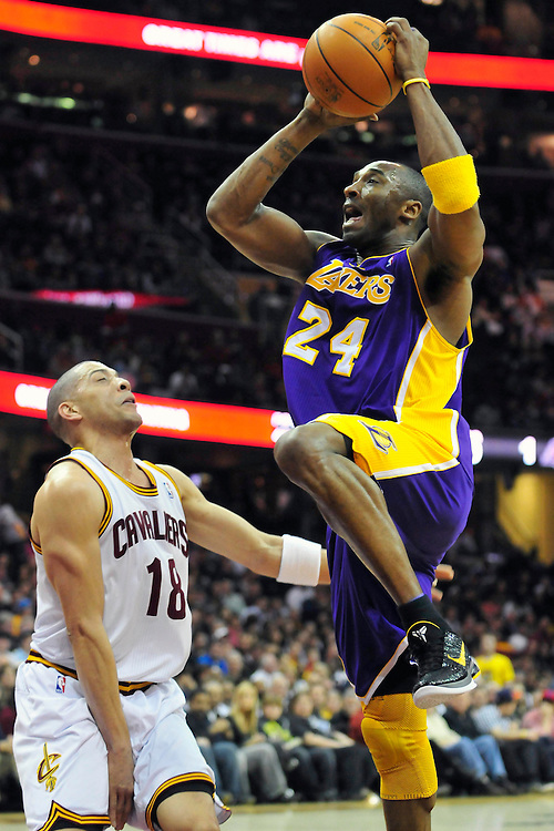 Feb. 16, 2011; Cleveland, OH, USA; Los Angeles Lakers shooting guard Kobe Bryant (24) shoots over Cleveland Cavaliers shooting guard Anthony Parker (18) during the first quarter at Quicken Loans Arena. Mandatory Credit: Jason Miller-US PRESSWIRE