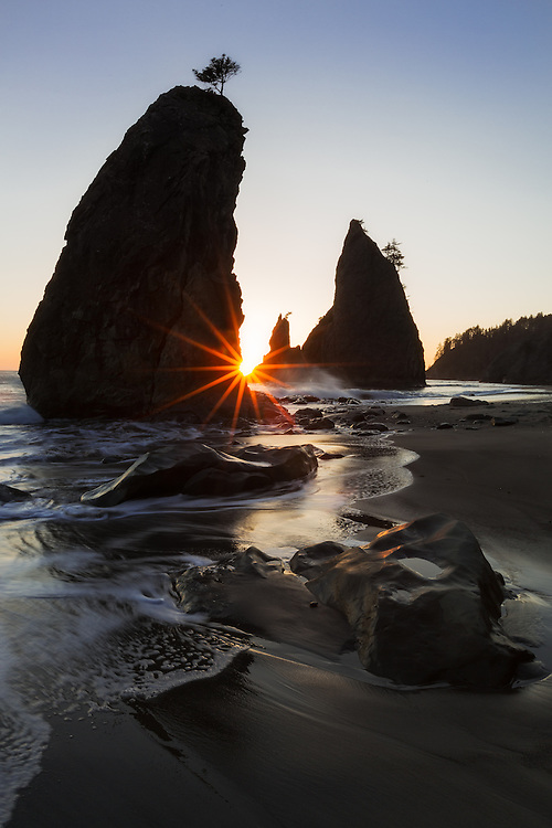 Sun star and sunset at Split Rocks, Rialto Beach, Olympic National Park, Washington.