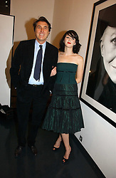 BRYAN FERRY and KATIE TURNER at a private view of an exhibition of portrait photographs by Danish photographer Marc Hom held at the Hamiltons Gallery, 13 Carlos Place, London on 23rd October 2006.<br /><br />NON EXCLUSIVE - WORLD RIGHTS