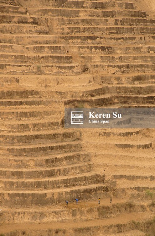 Farmers cultivating on the terraces built onto the steep mountain side, Loess Plateau in the Huanghe (Yellow River) region, Shaanxi Province, China