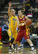 December 09 2010: Iowa St. guard Lauren Mansfield (10) tries to pass around Iowa guard Kamille Wahlin (2) during the first half of their NCAA basketball game at Carver-Hawkeye Arena in Iowa City, Iowa on December 9, 2010. Iowa defeated Iowa State 62-40 in the Hy-Vee Cy-Hawk Series rivalry game.