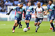 Wycombe Wanderers midfielder Curtis Thompson tackled by the opponent  during the EFL Sky Bet League 1 match between Bolton Wanderers and Wycombe Wanderers at the University of  Bolton Stadium, Bolton, England on 15 February 2020.