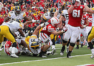November 25, 2011: Nebraska Cornhuskers running back Rex Burkhead (22) scores a touchdown on a run as he is pulled down by Iowa Hawkeyes defensive lineman Joe Gaglione (99) during the second half of the NCAA football game between the Iowa Hawkeyes and the Nebraska Cornhuskers at Memorial Stadium in Lincoln, Nebraska on Friday, November 25, 2011. Nebraska defeated Iowa 20-7.