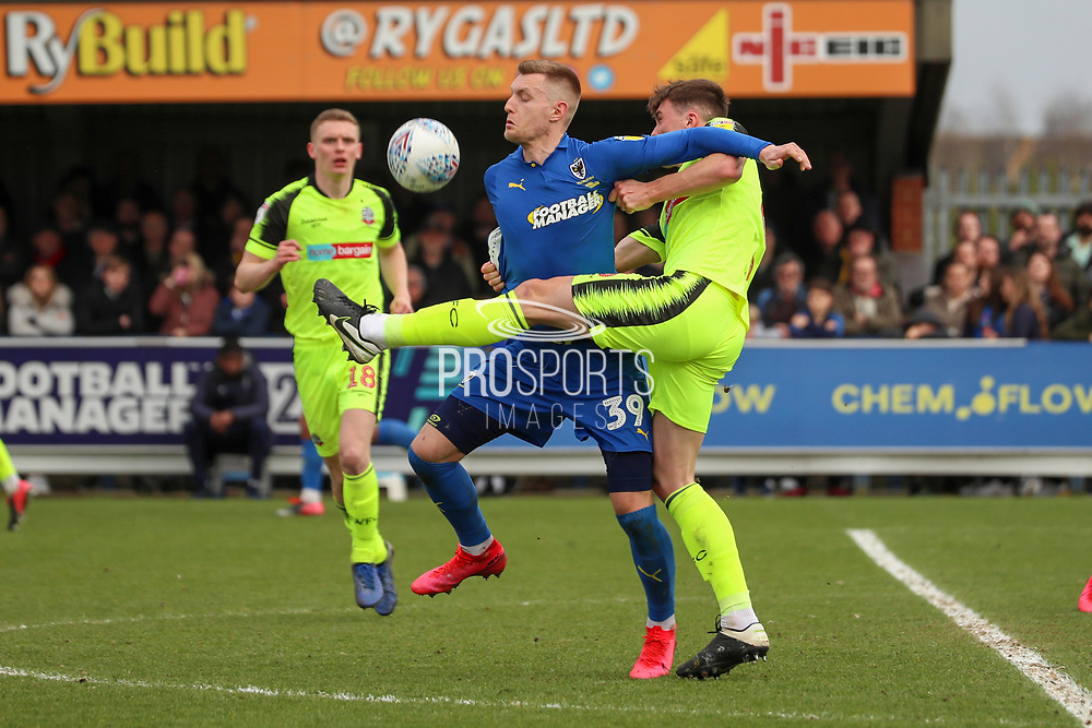 AFC Wimbledon striker Joe Pigott (39) and Bolton Wanderers defender Ryan Delaney (6) battles for possession during the EFL Sky Bet League 1 match between AFC Wimbledon and Bolton Wanderers at the Cherry Red Records Stadium, Kingston, England on 7 March 2020.