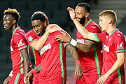 The Swansea City Players   celebrate with goalscorer (1-2)  Swansea City midfielder Leroy Fer (8) during the EFL Cup match between Milton Keynes Dons and Swansea City at stadium:mk, Milton Keynes, England on 22 August 2017. Photo by Dennis Goodwin.