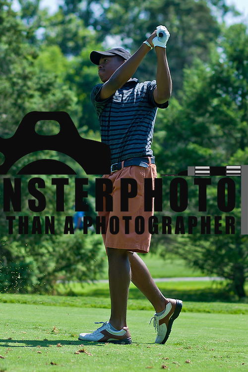 06/30/11 Newark DE: Golfer Aaron Burton (18) hits the ball towards hole 11 during round two of the DSGA and DWGA junior golf championships Thursday, June 30, 2011 at Newark Country Club in Newark Delaware.