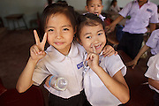 Mar. 10, 2009 -- VIENTIANE, LAOS: Young friends hang out together in their classroom after classes at an elementary school in Vientiane, Laos.  Photo by Jack Kurtz / ZUMA Press