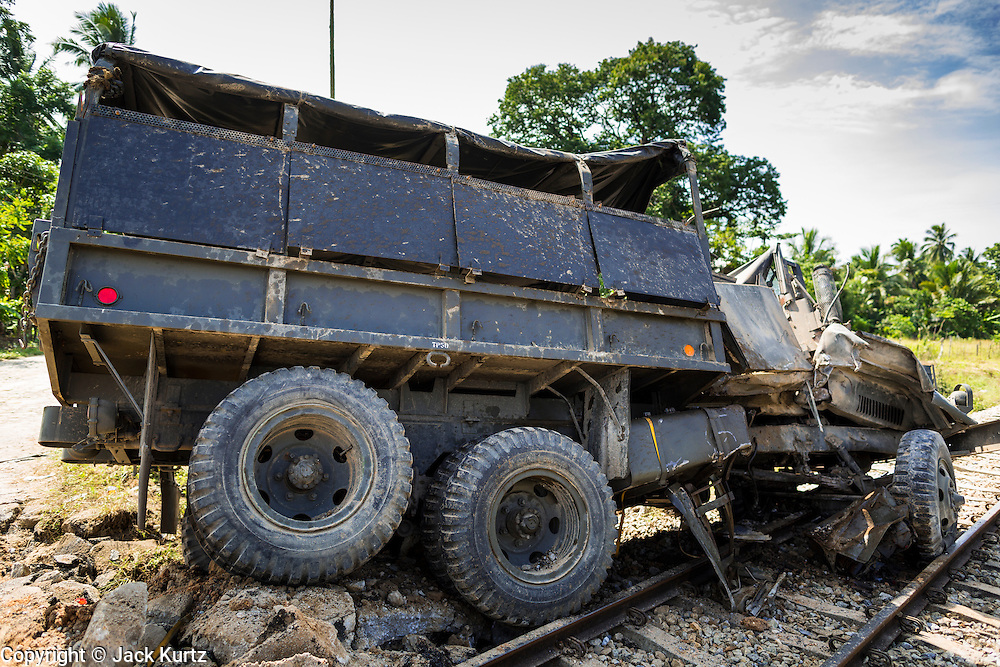 11 JULY 2013 - RAMAN, YALA, THAILAND: A Thai army truck after an IED attack destroyed it. Eight soldiers were injured when the IED exploded under a Thai Army truck carrying soldiers back to their camp after they finished a teacher protection mision. The army routinely dispatches soldiers to protect teachers and Buddhist monks, who have been targeted by Muslim insurgents as representatives of the Bangkok government. More than 5,000 people have been killed and over 9,000 hurt in more than 11,000 incidents in Thailand's three southernmost provinces and four districts of Songkhla since the insurgent violence erupted in January 2004, according to Deep South Watch, an independent research organization that monitors violence in Thailand's deep south region that borders Malaysia.    PHOTO BY JACK KURTZ