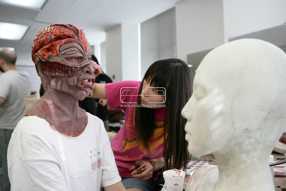 23rd October 2008, Los Angeles, California. Extreme Makeover!  Students at the Cinema Makeup School in Hollywood California, graduate from a special effects make-up course.  In this part of the course, movie industry hopefuls learn to design and create latex masks over a period of four weeks, before demonstrating their competence by transforming models into drag queens, aliens and monsters in only eight hours. Pictured is: Ashley Kim (23). PHOTO © JOHN CHAPPLE / REBEL IMAGES.john@chapple.biz    www.chapple.biz.(001) 310 570 9100.