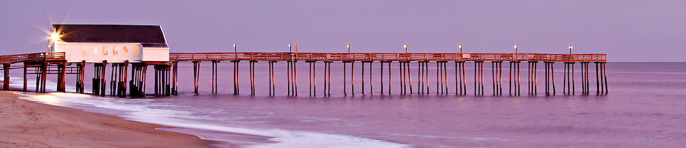 A soft pink sunrise at Kitty Hawk Fishing Pier.