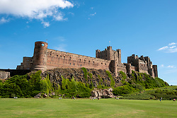 Bamburgh Castle is situated on the coast of Northumberland, England, UK, overlooking the village of Bamburgh. Originally the location of ancient forts the Normans built a new castle on the site which forms the core of the current one. The castle was left to deteriorate in the 17th century but it was then restored throughout the 18th and 19th centuries before being purchased by the industrialist William Armstrong in 1894 who completed the restoration. The castle, which is open to the public, continues to be owned by the Armstrong family.<br /> Photo: Ed Maynard<br /> 07976 239803<br /> www.edmaynard.com