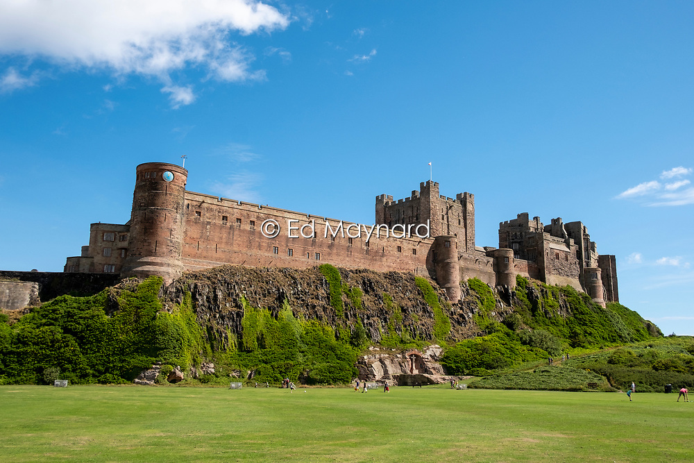 Bamburgh Castle is situated on the coast of Northumberland, England, UK, overlooking the village of Bamburgh. Originally the location of ancient forts the Normans built a new castle on the site which forms the core of the current one. The castle was left to deteriorate in the 17th century but it was then restored throughout the 18th and 19th centuries before being purchased by the industrialist William Armstrong in 1894 who completed the restoration. The castle, which is open to the public, continues to be owned by the Armstrong family.<br />