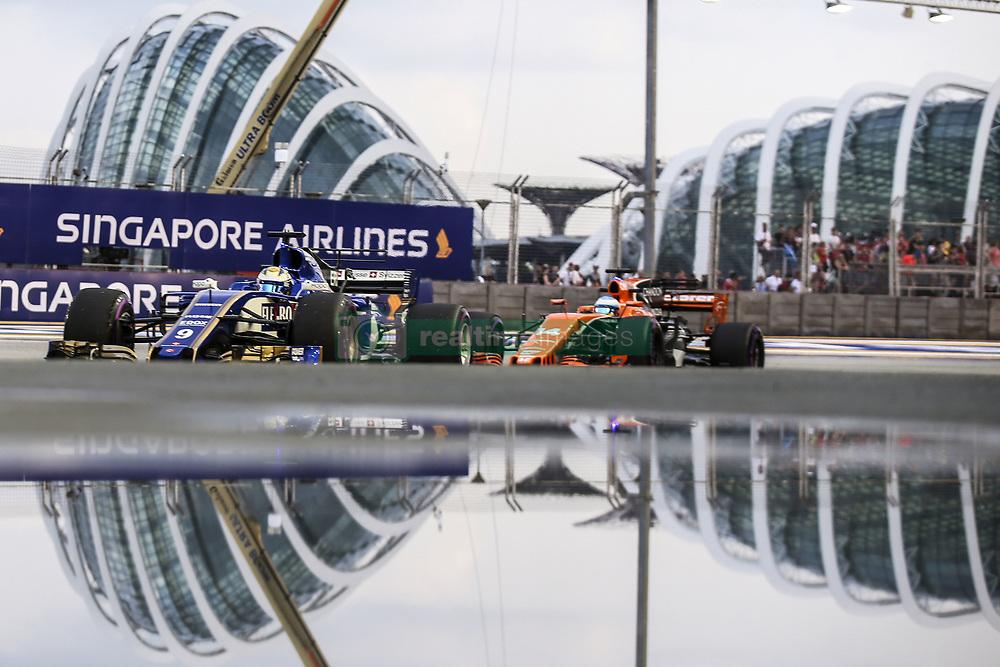 September 15, 2017 - Singapore, Singapore - Motorsports: FIA Formula One World Championship 2017, Grand Prix of Singapore, ..#9 Marcus Ericsson (SWE, Sauber F1 Team), #14 Fernando Alonso (ESP, McLaren Honda) (Credit Image: © Hoch Zwei via ZUMA Wire)
