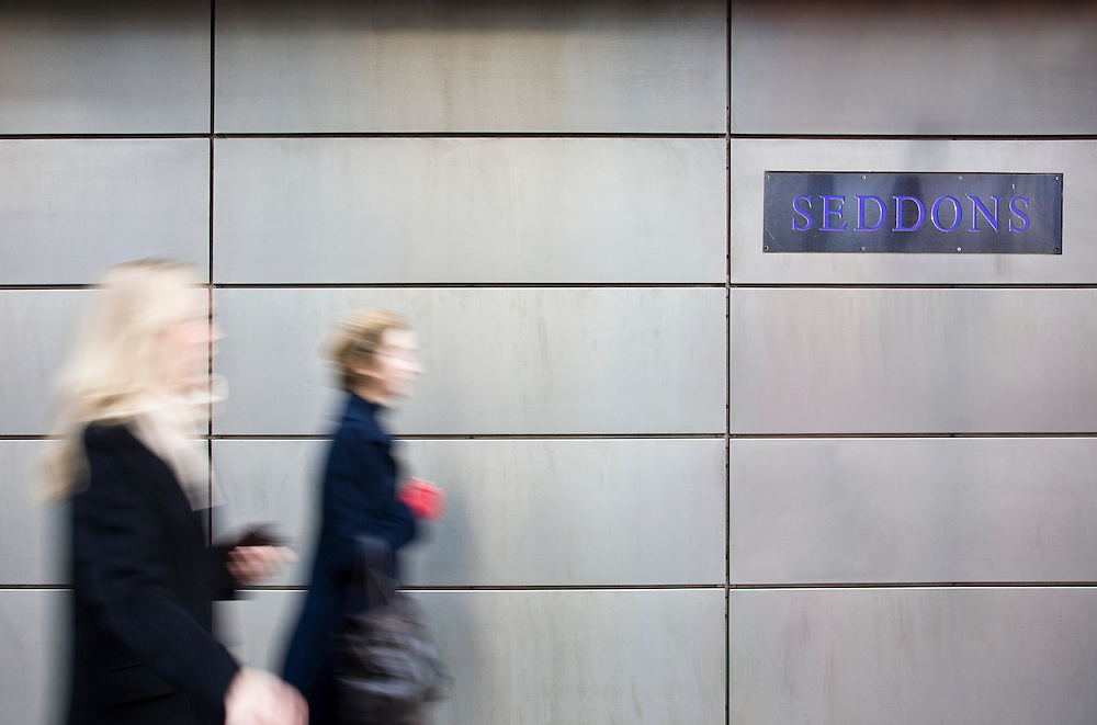 office workers in portman square, london, walking past a law firm