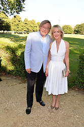 DAVID MELLOR and his wife PENNY at the Frost Family Summer party in support of the British Heart Foundation and the Mile Frost Fund held at Burton Court, Chelsea, London  on 18th July 2016.