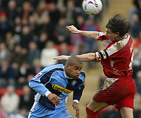 Photo: Chris Ratcliffe.<br />Leyton Orient v Wycombe Wanderers. Coca Cola League 2. 25/03/2006.<br />Wycombe player Jermaine Easton is beaten to a header by John Mackie of Leyton Orient