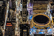Aerial view of Madison Square Garden in New York City, photographed at night from a helicopter, showing the New Yorker Hotel to the left.