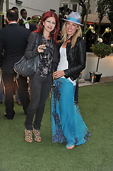 Left to right, CAROL ARIDA and JANE MUNRO-HALL at a garden party hosted by Piaget at The Hempel Hotel, London on 14th July 2011.