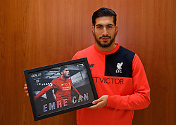 LIVERPOOL, ENGLAND - Friday, December 9, 2016: Liverpool's Emre Can with the Goal 25 award at the club's Melwood Training Ground. (Pic by David Rawcliffe/Propaganda)
