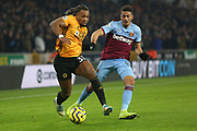 Adam Troare goes past Pablo Fornals during the Premier League match between Wolverhampton Wanderers and West Ham United at Molineux, Wolverhampton, England on 4 December 2019.