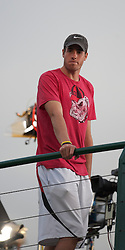 LONDON, ENGLAND - Thursday, June 24, 2010: John Isner (USA) watches as the opponent he defeated in the longest tennis match ever, Nicolas Mahut (FRA), plays in the Gentlemen's Doubles 1st Round match on day four of the Wimbledon Lawn Tennis Championships at the All England Lawn Tennis and Croquet Club. (Pic by David Rawcliffe/Propaganda)