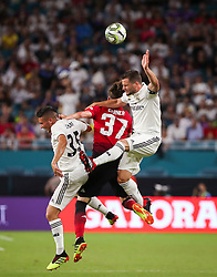 July 31, 2018 - Miami Gardens, Florida, U.S. - Real Madrid C.F. defender NACHO FERNANDEZ (6) (right) leaps to head the ball above Manchester United F.C. defender JAMES GARNER(37) (center) Real Madrid C.F. midfielder OSCAR RODRIGUEZ (35) (left) during an International Champions Cup match between Real Madrid C.F. and Manchester United F.C. at the Hard Rock Stadium. Manchester United F.C. won the game 2-1. (Credit Image: © Mario Houben via ZUMA Wire)