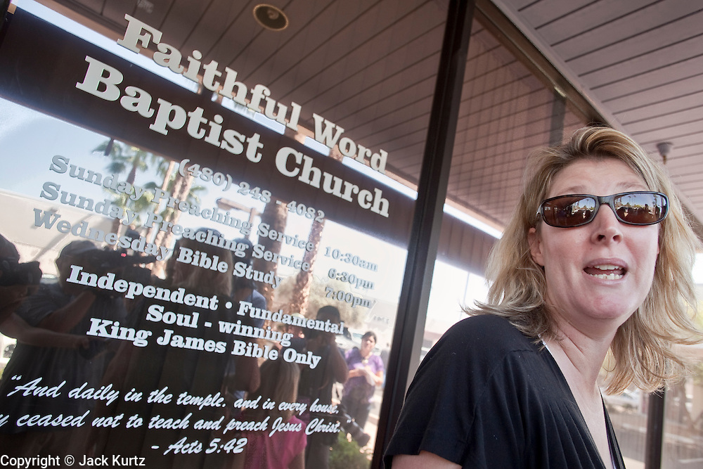 """Sept. 6, 2009 -- TEMPE, AZ: Congregants at the Faithful Word Baptist Church argue with reporters as they leave church services Sunday. Steven Anderson, the minister at the Faithful Word Baptist Church, an independent fundamentalist Baptist church, in Tempe has repeatedly said he hoped US President Barack Obama would die from a brain tumor and Sunday, Sept. 6, reiterated that he """"hates"""" President Obama. More than 200 people from a variety of liberal and progressive churches in the Phoenix area picketed Anderson's church Sunday morning, outnumbering his small congregation of about 50. Most of the church members supported Rev. Anderson's comments.  Photo by Jack Kurtz"""
