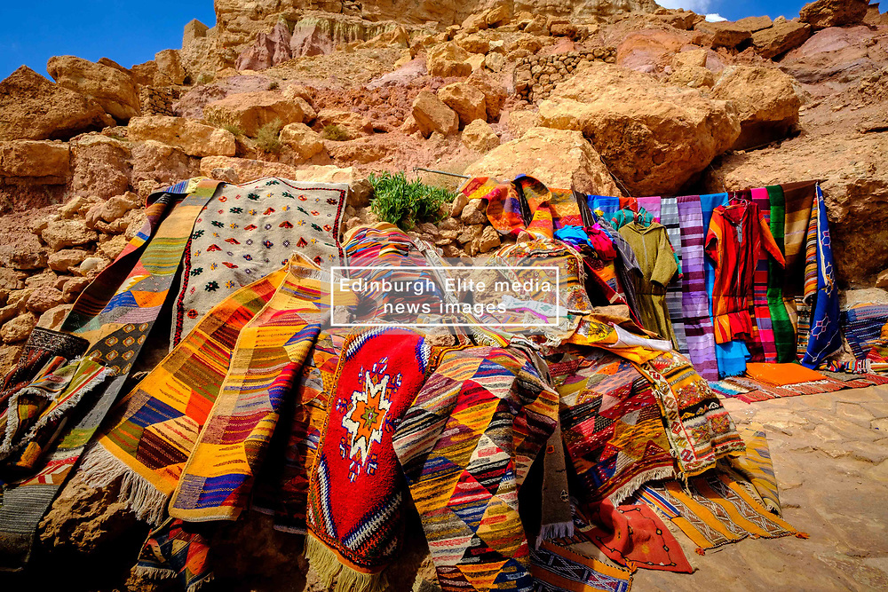 Goods for sale in a stall in Aït Benhaddou, Morocco. Aït Benhaddou is an ighrem (fortified village), situated along the former caravan route between the Sahara and Marrakech in present-day Morocco. There are four families still living in the ancient village. Inside the walls of the ksar are half a dozen (Kasbahs) or merchants houses and other individual dwellings, and is a great example of Moroccan earthen clay architecture.<br /> <br /> Aït Benhaddou has been a UNESCO World Heritage Site since 1987.<br /> <br /> (c) Andrew Wilson | Edinburgh Elite media