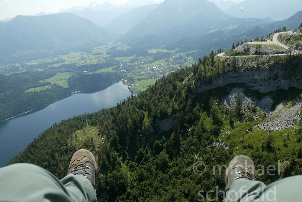 Taking a tandem paragliding trip near the town of Altaussee, with the Altausseer See below..Covering the Red Bull X Alps race 2007, Austria..Pic © Michael Schofield..