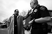 83777----  02.17.05  ----   Pastor Rock talks with Patrol Officer Cody McGrew at the Sugar Hill in McKinney on 17 February, 2005..Pastor Rock has spent the past three years fighting race, poverty  and violence at Sugar Hill, the poorest of the poor living in public housing in Texas' richest county, Collin County. Originating in 1969, the McKinney apartment complex rose next to an old cotton field, with 100 units that would battle decades of economic annd racial isolation, squalor, criminal neglect, crack cocaine and bureaucratic equivocation supported by millions of taxpayer dollars.