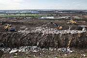 The government said recently that Britain only has enough landfill space left for another eight years. We currently send 18.8 million tonnes of rubbish to landfill every year – 2 million more tonnes than any other country in Europe. By 2013, only 50 per cent of Britain's waste will be allowed to go to landfill. This landfill site is owned by SITA and is one of the largest sites in Europe stretching over 400 acres. In this particular section of the landfill, rubbish is brought to the site and is seperated by tractors. Packington, Warwickshire, UK. 2011