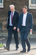 © Licensed to London News Pictures. 08/07/2014. Westminster, UK Sir George Young, Conservative MP, Chief Whip and Jeremy Hunt, Conservative MP, Secretary of State for Health,  arriving on Downing Street today 8th July 2014 for the weekly cabinet meeting. Photo credit : Stephen Simpson/LNP
