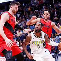 09 April 2018: Denver Nuggets forward Will Barton (5) drives past Portland Trail Blazers center Jusuf Nurkic (27) during the Denver Nuggets 88-82 victory over the Portland Trail Blazers, at the Pepsi Center, Denver, Colorado, USA.
