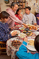 At her suburban home in south Anchorage, Gladys treats her vsiting kids and grandchildren to a traditional meal of dried white fish, walrus, caribou, goose soup, dried salmon, fresh greens with herring eggs and agutak, a mixture of fat, white fish, salmonberries, blackberries, and blueberries.