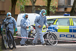 © Licensed to London News Pictures. 19/05/2016. London, UK. A police forensics team entering a property at the Maitland Park Estate in Hampstead, North London, where the body of a woman in her 40s was found.   A murder investigation has been launched. Photo credit: Ben Cawthra/LNP