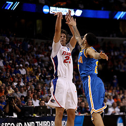 Mar 19, 2011; Tampa, FL, USA; Florida Gators forward Chandler Parsons (25) shoots over UCLA Bruins forward Tyler Honeycutt (23) during first half of the third round of the 2011 NCAA men's basketball tournament at the St. Pete Times Forum.  Mandatory Credit: Derick E. Hingle