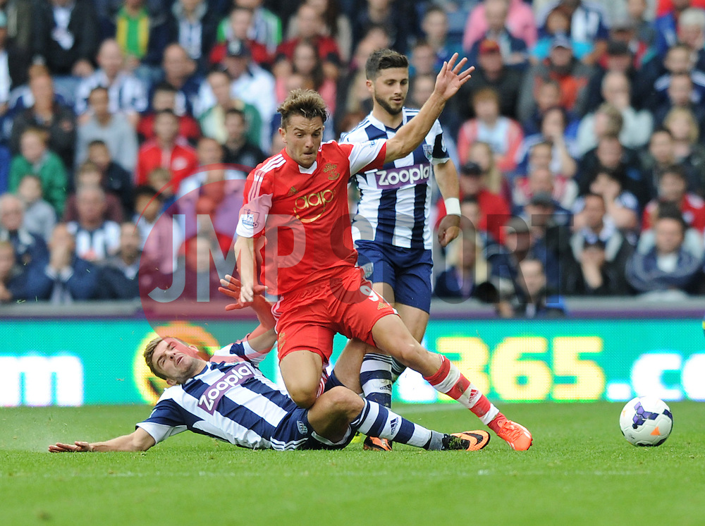 Southampton's Jay Rodriguez gets tackled by West Bromwich Albion's Graham Dorrans  - Photo mandatory by-line: Alex James/JMP - Tel: Mobile: 07966 386802 17/08/2013 - SPORT - FOOTBALL - The Hawthorns - West Bromwich -  West Brom V Southampton - Barclays Premier League