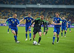 KIEV, UKRAINE - Easter Monday, March 28, 2016: Wales' Shaun MacDonald in action against Ukraine during the International Friendly match at the NSK Olimpiyskyi Stadium. (Pic by David Rawcliffe/Propaganda)