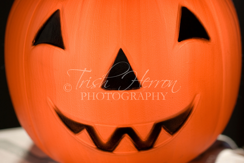 Bright orange plastic Halloween jack-ol-lantern.