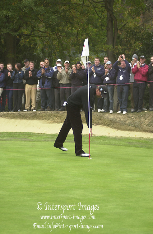 2003 HSBC World Match Play Championship - Wentworth.Sunday - Final Day- Ernie Els v Thomas Bjorn:.Ernie Els checks the torphy over after winning on the 14th of the afternoon round.... [Credit, Peter Spurrier/Intersport-images]19.10.2003