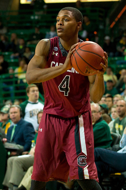 WACO, TX - NOVEMBER 12: Tyrone Johnson #4 of the South Carolina Gamecocks brings the ball up court against the Baylor Bears on November 12, 2013 at the Ferrell Center in Waco, Texas.  (Photo by Cooper Neill/Getty Images) *** Local Caption *** Tyrone Johnson