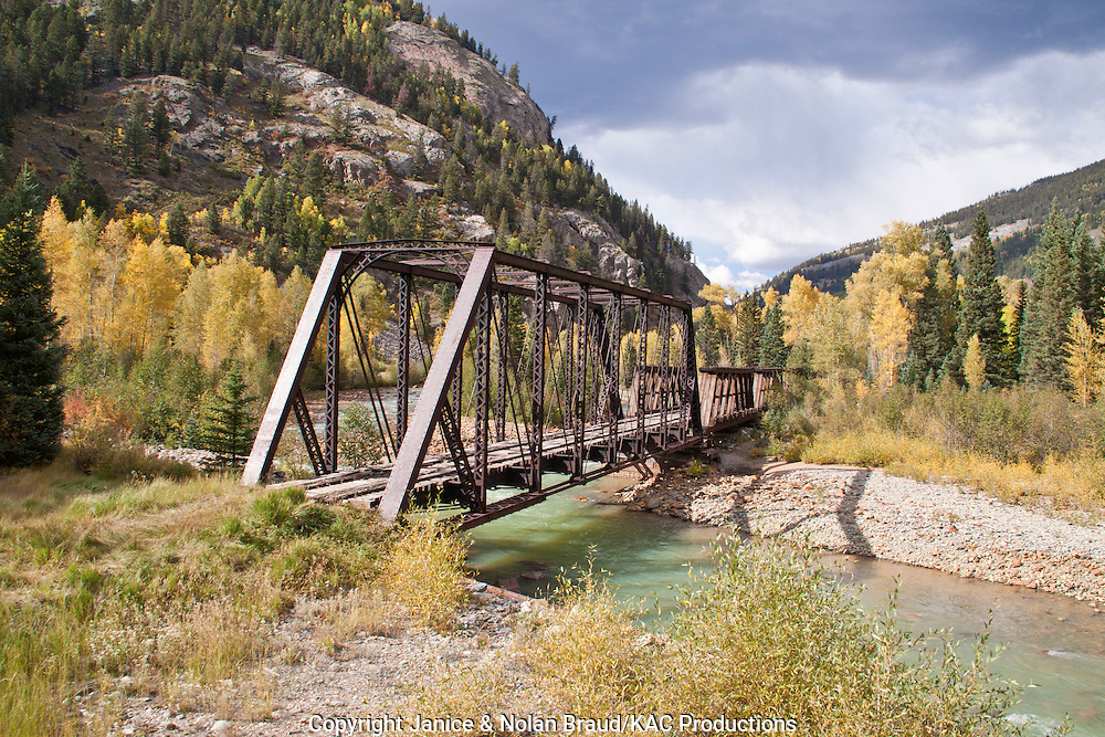 Abandoned railroad bridge over the Animas River on the Durango and Silverton Narrow Gauge Railroad line from Durango to Silverton in Colorado.