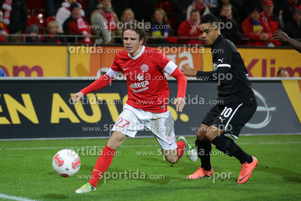 15.12.2012, Coface Arena, Mainz, GER, 1. FBL, 1. FSV Mainz 05 vs VfB Stuttgart, 17. Runde, im Bild Nicolai MUELLER - MULLER (FSV Mainz 05 - 27) - Daniel DIDAVI (VfB Stuttgart - 10) // during the German Bundesliga 17th round match between 1. FSV Mainz 05 and VfB Stuttgart at the Coface Arena, Mainz, Germany on 2012/12/15. EXPA Pictures © 2012, PhotoCredit: EXPA/ Eibner/ Gerry Schmit..***** ATTENTION - OUT OF GER *****
